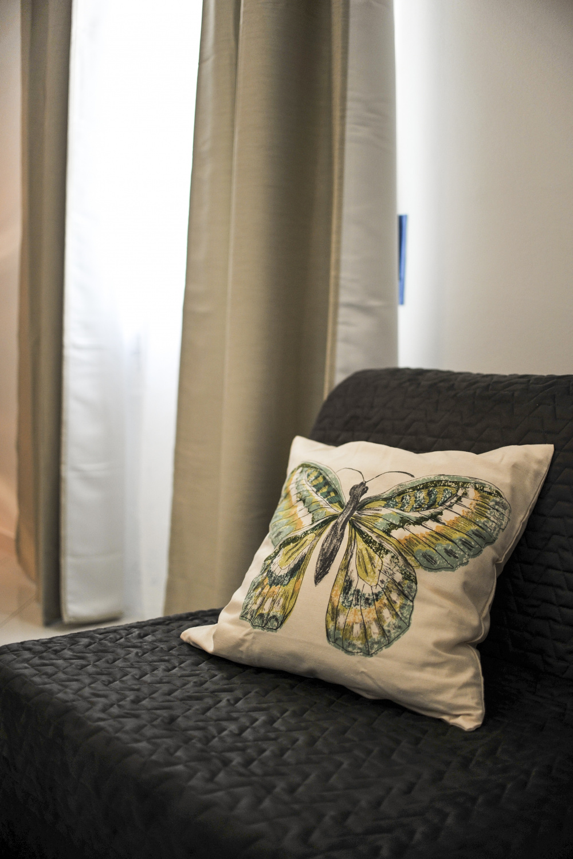 Camera Licena quadrupla butterfly Livorno